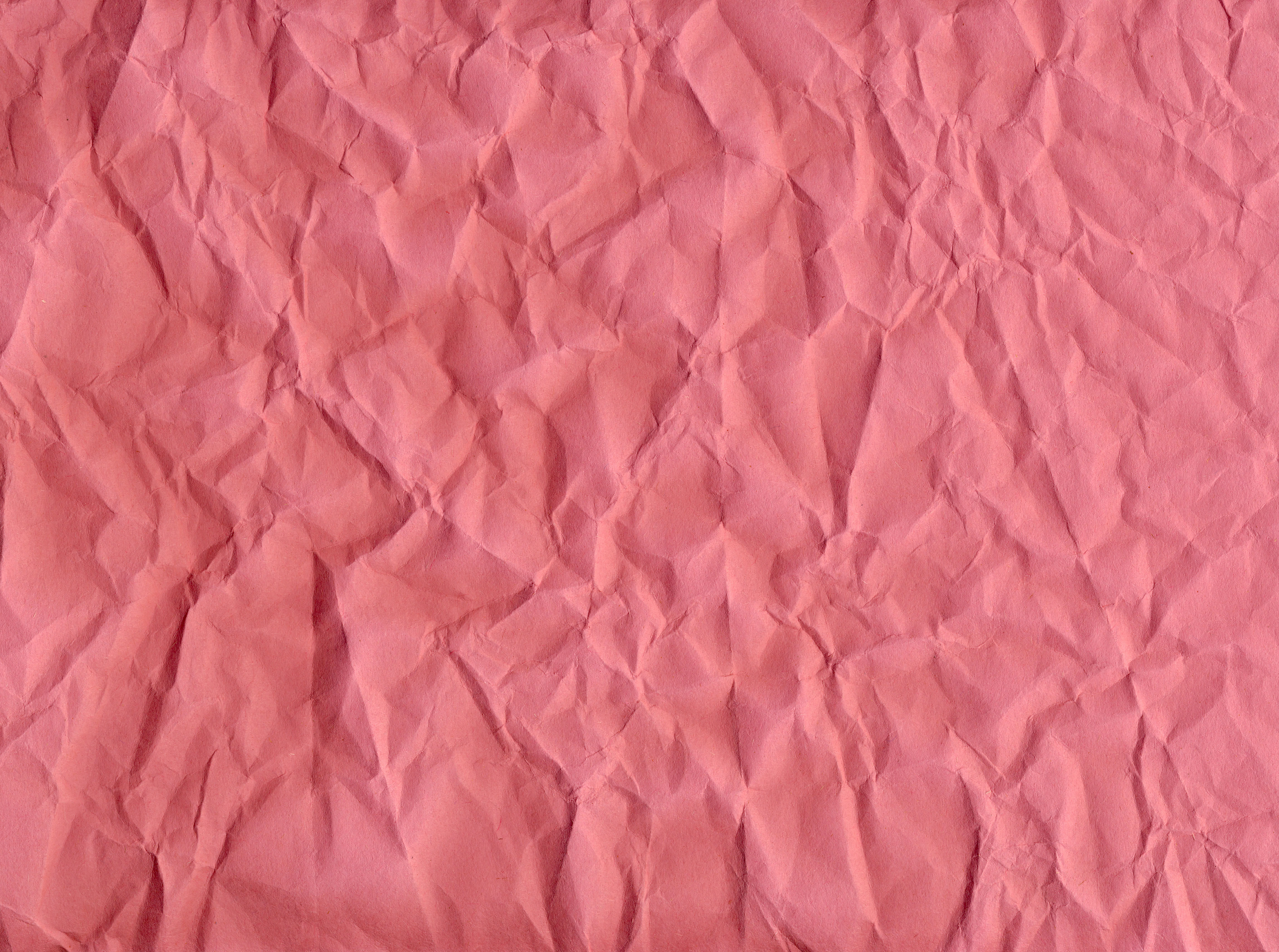 pink creased paper texture background