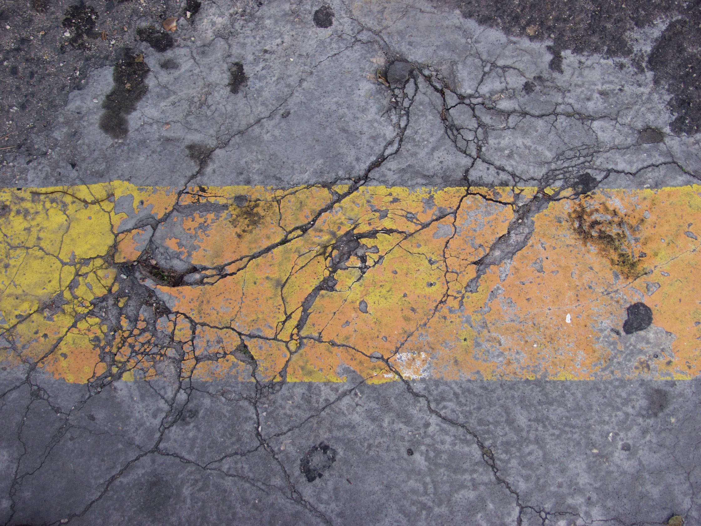 Damaged and broken asphalt background, texture